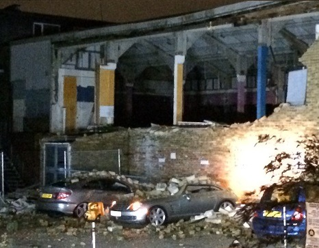 Cars Damaged In Partial Building Collapse