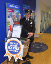 Fundraising 'Whistling Postie' Dale Wins Recognition